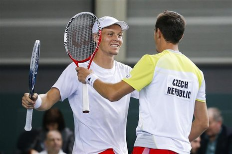 Tomas Berdych (L) of the Czech Republic celebrates with his team mate Lukas Rosol after winning his Davis Cup world group round 1 tennis dou