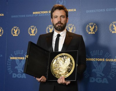 Ben Affleck poses for photographers with the Feature Film Award at the 65th annual Directors Guild of America Awards in Los Angeles, Februar