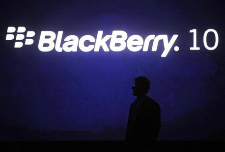 Research in Motion Chief Executive Officer Thorsten Heins is silhouetted during the BlackBerry World event in Orlando, in this file picture