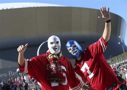 San Francisco 49ers fans cheer in front of the Superdome before the NFL Super Bowl XLVII football game against the Baltimore Ravens in New O