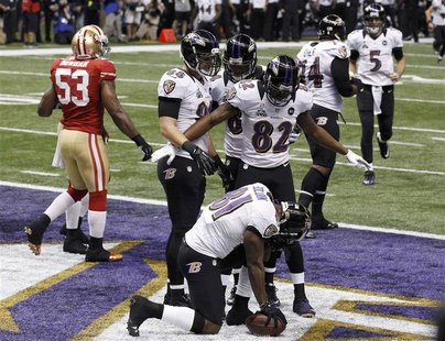 Baltimore Ravens wide receiver Anquan Boldin celebrates his touchdown with teammates Torrey Smith (82), and Dennis Pitta (88) against the Sa