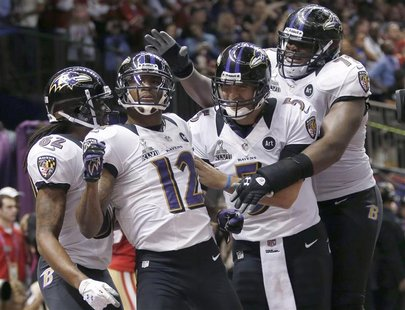 Baltimore Ravens wide receiver Jacoby Jones (12) celebrates his second quarter touchdown against the San Francisco 49ers with teammates Joe
