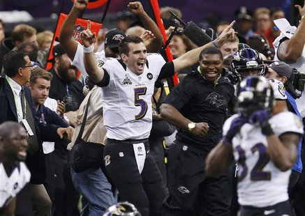 Baltimore Ravens quarterback Joe Flacco celebrates as the Ravens defeat the San Francisco 49ers to win the NFL Super Bowl XLVII football gam