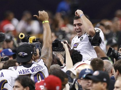 Baltimore Ravens MVP quarterback Joe Flacco (R) celebrates victory over the San Francisco 49ers in the Super Bowl XLVII football game in New