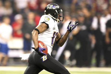 Baltimore Ravens' Jacoby Jones heads up field en route to scoring a touchdown on a kickoff return at the start of the third quarter against