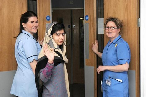 Pakistani schoolgirl Malala Yousufzai (C) waves with nurses as she is discharged from The Queen Elizabeth Hospital in Birmingham in this han