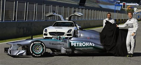 Mercedes Formula One racing driver Lewis Hamilton (L) of Britain and teammate Nico Rosberg of Germany unveil the new Mercedes W04 Formula On