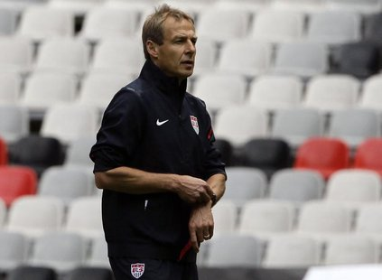 Head coach of the U.S. national soccer team Jurgen Klinsmann of Germany looks at his players during a practice session at the Azteca stadium