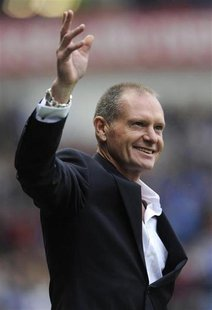 Ex-Rangers' player Paul Gascoigne reacts to the supporters' reception for him at half time during their Scottish Premier League soccer match