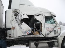 Semi tractor damaged by snowplow truck