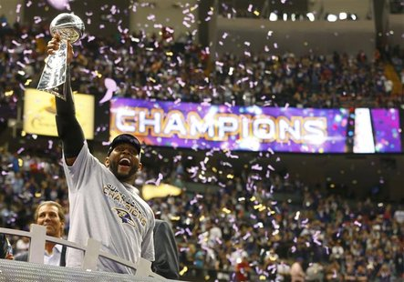 Baltimore Ravens inside linebacker Ray Lewis hoists the Vince Lombardi Trophy as he celebrates victory over the San Francisco 49ers in their