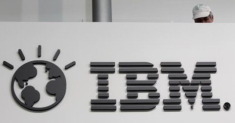 A worker is pictured behind a logo at the IBM stand on the CeBIT computer fair in Hanover February 26, 2011. The world's largest IT fair CeB