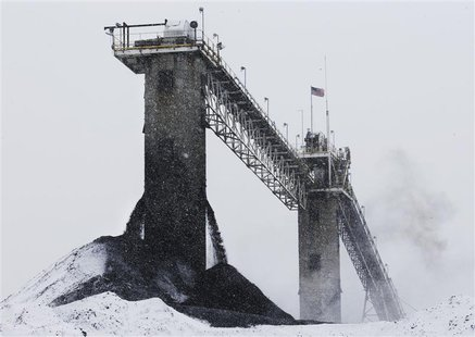 Processed coal streams out into a pile after being cleaned in the prep plant at the Century Mine near Beallsville, Ohio, January 25, 2013. W
