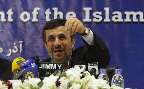 Iran's President Mahmoud Ahmadinejad speaks during a media conference at Iran's embassy after he attended the Developing-8 summit in Islamab