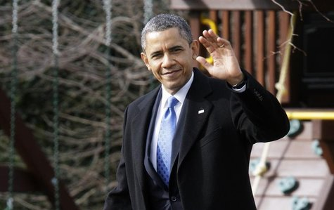 President Barack Obama waves to reporters as he walks across the South Lawn to board the Marine One helicopter for departure to Minnesota fr