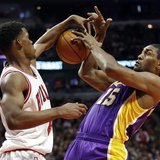 Chicago Bulls small forward Jimmy Butler (L) blocks the shot of Los Angeles Lakers small forward Metta World Peace during the first half of