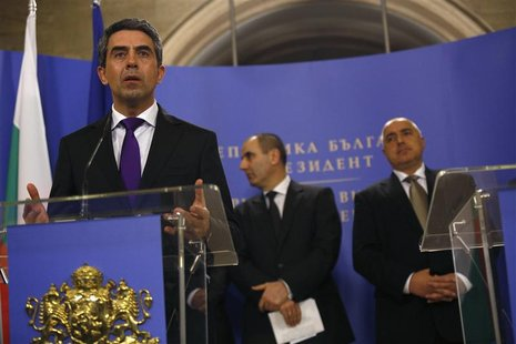 Bulgarian President Rosen Plevneliev (L) speaks during a joint news conference with Prime Minister Boiko Borisov (R) and Interior Minister T