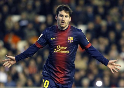 Barcelona's Lionel Messi celebrates after he scored a penalty against Valencia during their Spanish first division soccer match at the Mesta