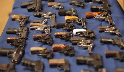 A view shows confiscated guns on a table during a news conference where New York City Mayor Michael Bloomberg, Police Commissioner Ray Kelly