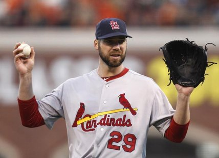 St. Louis Cardinals starting pitcher Chris Carpenter looks to catcher Yadier Molina in the fourth inning as he pitches against the San Franc