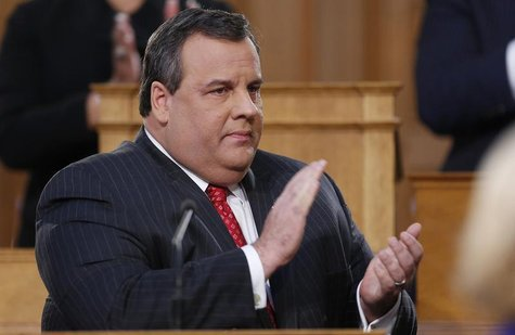 New Jersey Governor Chris Christie claps while giving his State of the State address in the assembly chamber in Trenton, New Jersey, January