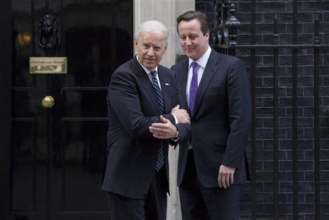 Britain's Prime Minister David Cameron (R) bids farewell to U.S. Vice President Joe Biden at Number 10 Downing Street in London February 5,