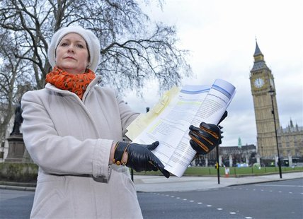 Julie Bailey, the founder of Cure The NHS, holds a copy of the report into the failings at mid-Staffordshire NHS Trust, outside the Houses o