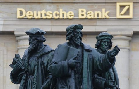 A statue is pictured in front of the former head quarters of Germany's largest business bank, Deutsche Bank in Frankfurt, January 28, 2013.