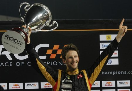 Driver Romain Grosjean from Team France holds up Race of Champions (ROC) trophy after winning over Tom Kristensen from Team All Stars at the