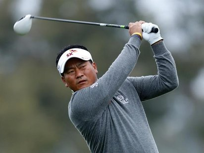 South Korean golfer K.J. Choi hits off the 2nd tee during weather delayed third round play at the Farmers Insurance Open in San Diego, Calif