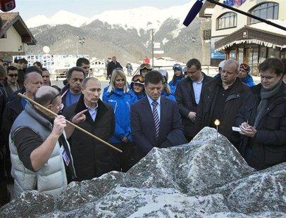 Russia's President Vladimir Putin (2nd L) listens to Interros Company President Vladimir Potanin (L) as he visits the Rosa Khutor Alpine Cen