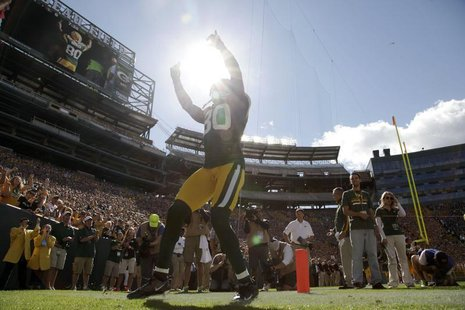 Green Bay Packers' Donald Driver is announced before the start of the NFL football game against the San Francisco 49ers in Green Bay, Wiscon