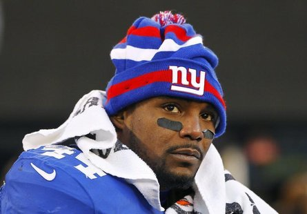 New York Giants' Ahmad Bradshaw sits on the bench in the final minutes of their NFL football game against the Philadelphia Eagles in East Ru