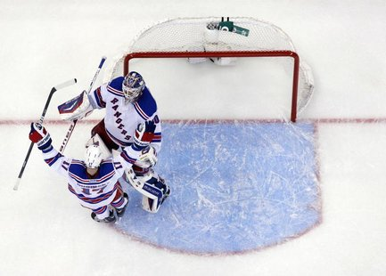 New York Rangers' Brandon Dubinsky celebrates with goalie Henrik Lundqvist after beating the Ottawa Senators in game 3 of their NHL Eastern