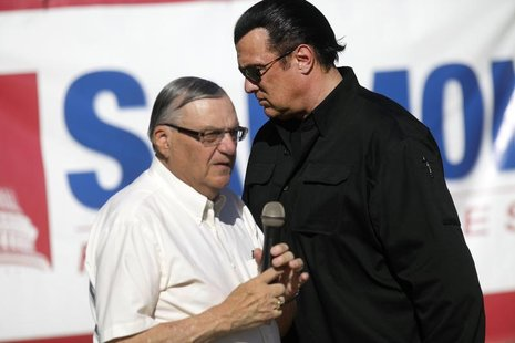 Maricopa County Sheriff Joe Arpaio (L) is introduced by actor Steven Seagal during a campaign rally in Mesa, Arizona October 27, 2012. REUTE