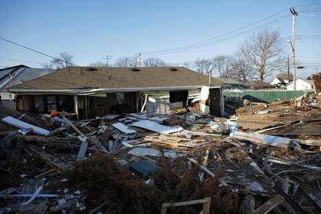 A view of a house destroyed by Superstorm Sandy with its debris still uncleared at Staten Island in New York January 4, 2013. REUTERS/Eduard