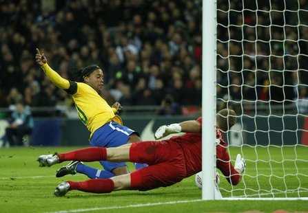 England's goalkeeper Joe Hart (R) makes a double penalty save against Brazil's Ronaldinho during their international friendly soccer match a