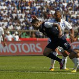 Clint Dempsey (L) of the U.S. is challenged by Honduras' Victor Bernardez (C) and Roger Espinoza during their 2014 World Cup qualifying socc