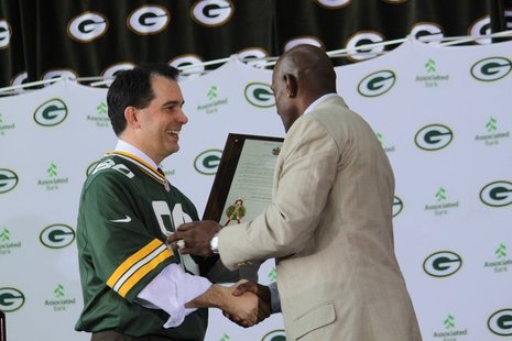 "Governor Scott Walker issues proclamation of ""Donald Driver Day"" in Wisconsin during Lambeau Field retirement ceremony on Feb. 6, 2013."