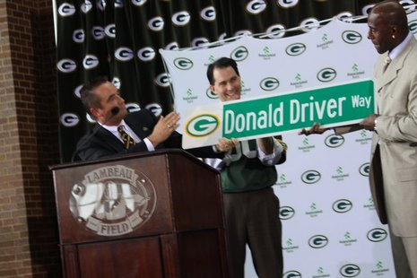 "Green Bay Mayor Jim Schmitt unveils ""Donald Driver Way"" street sign during Lambeau Field retirement ceremony on Feb. 6, 2013."