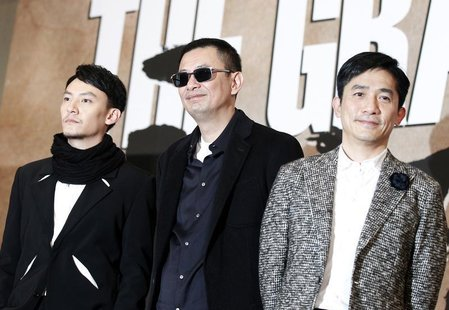 Hong Kong director Wong Kar Wai (C), actor Tony Leung (R) and Taiwanese actor Chang Chen pose during a news conference to promote their new