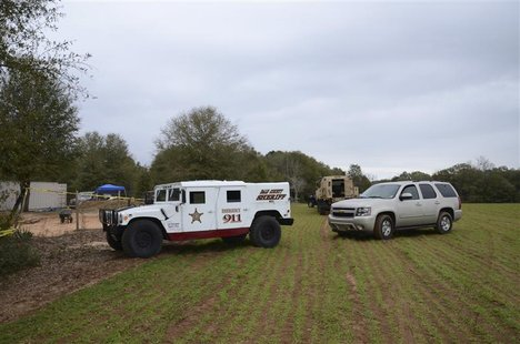 Authorities secure the residence of Jimmy Lee Dykes where a five-year-old boy was rescued after being held hostage for almost one week in an