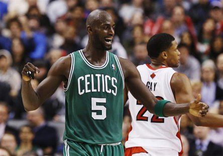 Boston Celtics' Kevin Garnett celebrates against the Toronto Raptors during the first half of their NBA basketball game in Toronto, February