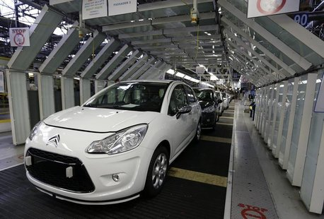 Citroen C3 automobiles are seen on the idled assembly line as striking employees prevent their colleagues from working at the PSA-Peugeot Ci