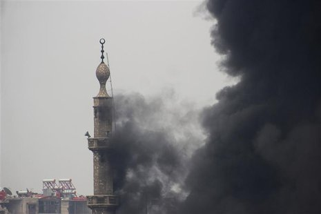 Smoke comes out from a mosque tower during heavy fighting between the Free Syrian Army and President Bashar al-Assad's forces, in the Jobar