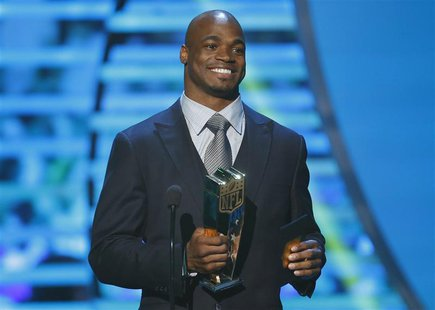 Minnesota Vikings running back Adrian Peterson accepts the NFL MVP award during the NFL Honors awards show in New Orleans, Louisiana Februar