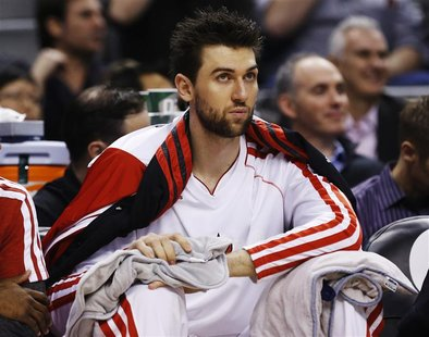 Toronto Raptors' Andrea Bargnani sits on the bench during the first half of their NBA basketball game against the Boston Celtics in Toronto,