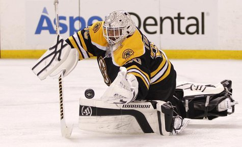 Boston Bruins goalie Tim Thomas makes a save against the Washington Capitals during the third period in Game 7 of their NHL Eastern Conferen