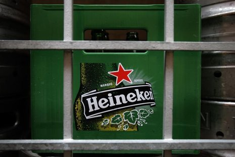 A plastic container with empty bottles of Heineken beers are pictured among beer kegs outside a restaurant in Singapore August 29, 2012. REU