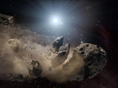 Image courtesy of NASA shows an artist's concept of a broken-up asteroid. Scientists think that a giant asteroid, which broke up long ago in